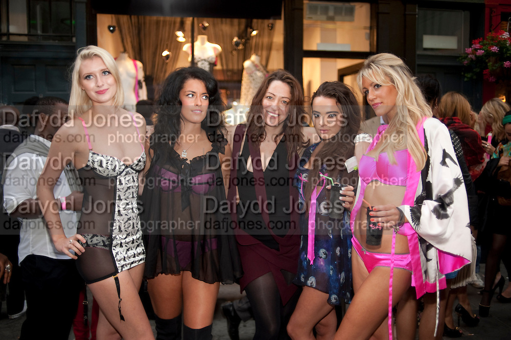 DEE MURRAY IN CENTRE OF MODELS, Dirty Pretty Things - summer party. Lingerie line hosts  party celebrating its new online shop and showcasing the latest collection. The Lingerie Collective, 8 Ganton Street, Soho. London, 15 June 2011<br /> <br />  , -DO NOT ARCHIVE-© Copyright Photograph by Dafydd Jones. 248 Clapham Rd. London SW9 0PZ. Tel 0207 820 0771. www.dafjones.com.
