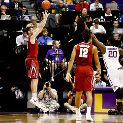 Jan 14, 2017; Baton Rouge, LA, USA; Alabama Crimson Tide guard Riley Norris (1) shoots over LSU Tigers forward Brian Bridgewater (20) during the second half of a game at the Pete Maravich Assembly Center. Alabama defeated LSU 81-66. Mandatory Credit: Derick E. Hingle-USA TODAY Sports