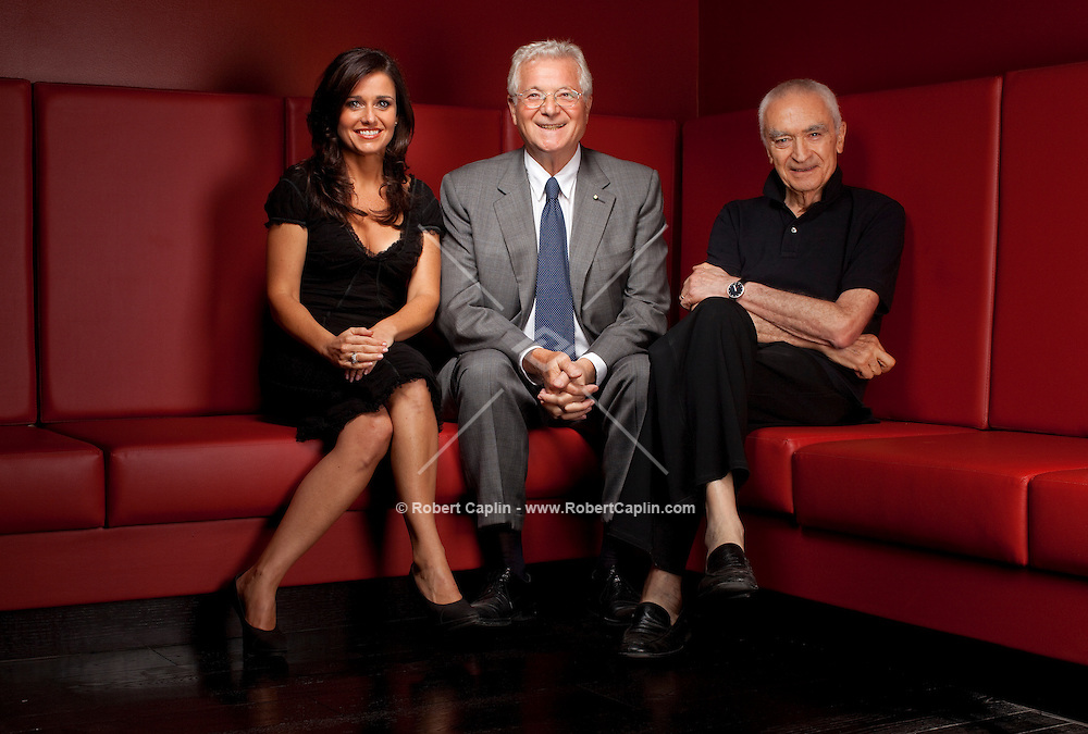 Tony May, center, with his daughter, Marisa May, left and  designer Massimo Vignelli at their newest restaurant, San Domenico in New York, NY on Tuesday, Aug. 25, 2009.