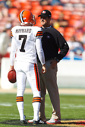 Oct 30, 2011; San Francisco, CA, USA; San Francisco 49ers head coach Jim Harbaugh talks to Cleveland Browns punter Brad Maynard (7) before the game at Candlestick Park. San Francisco defeated Cleveland 20-10. Mandatory Credit: Jason O. Watson-US PRESSWIRE
