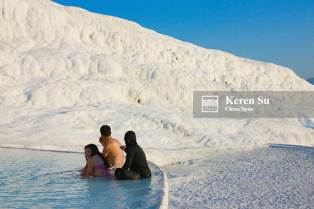 Tourists with travertine terraces of Pamukkale, Turkey