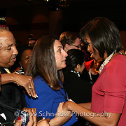 First Lady Michelle Obama speaks to a mayor at a National League of Cities event in Washington, DC.