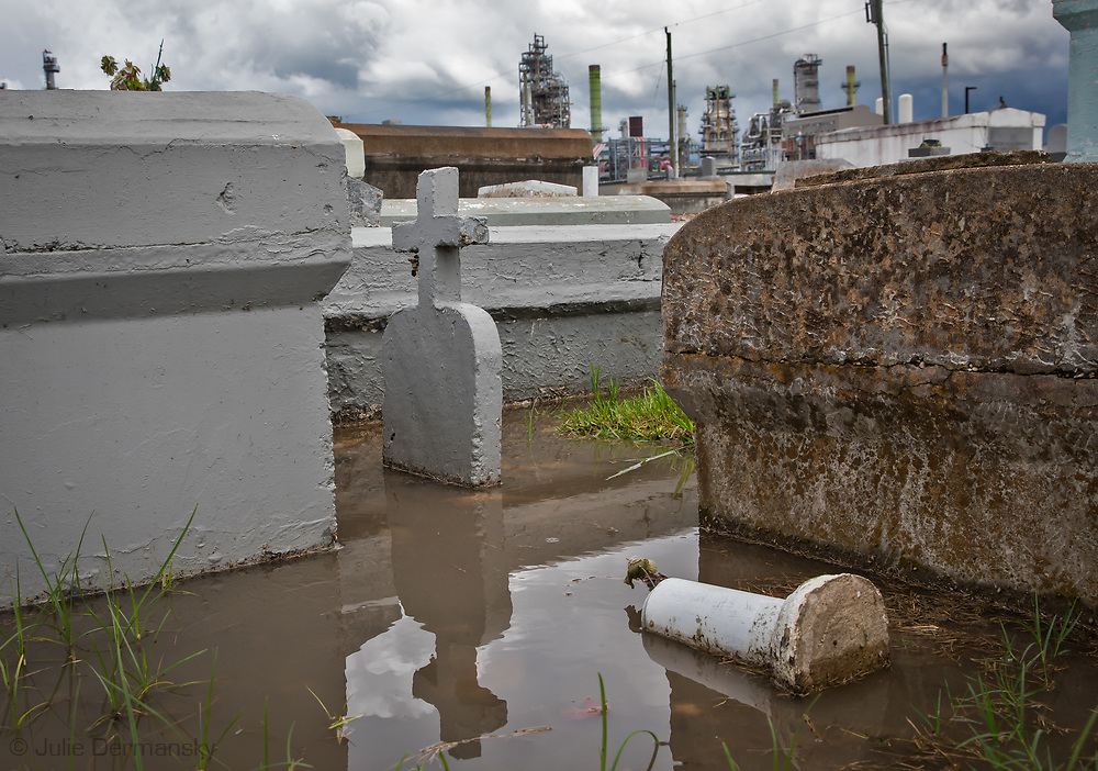 Standing water in the  Zion Travelers Cemetery in Reserve, Louisiana, in the heart of Cancer Alley. Next to the cemetery is the Marathon Refinery.