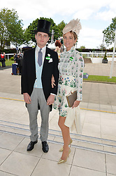 VISCOUNTESS ROTHERMERE and her son the HON.VERE HARMSWORTH at the Investec Derby 2015 at Epsom Racecourse, Epsom, Surrey on 6th June 2015.