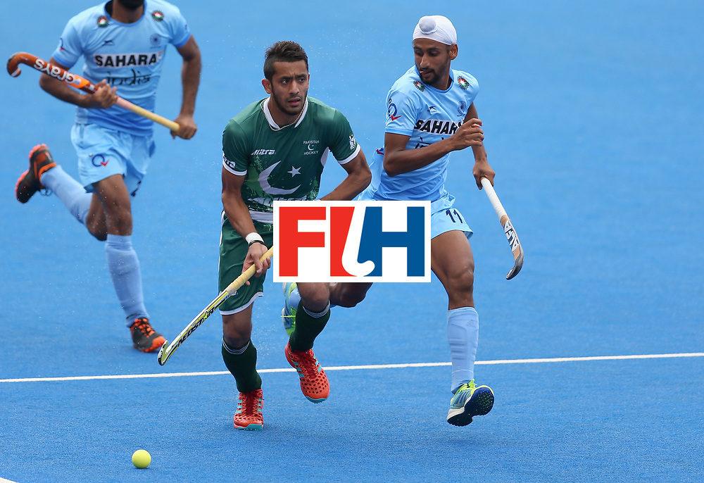 LONDON, ENGLAND - JUNE 24: Ammad Shakeel of Pakistan breaks away from Mandeep Singh of India during the 5th-8th place match between Pakistan and India on day eight of the Hero Hockey World League Semi-Final at Lee Valley Hockey and Tennis Centre on June 24, 2017 in London, England. (Photo by Steve Bardens/Getty Images)