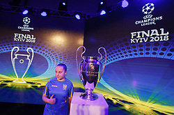 December 12, 2017 - Kiev, Ukraine - A girl poses for a photo near the UEFA Champions League trophy, during the presentation of the logo of the 2018 Champions League final soccer match in Kiev, Ukraine, 12 December, 2017.  The UEFA Champions League final will be played at the Olimpiyskiy stadium on 26 May 2018 in Kiev. (Credit Image: © Str/NurPhoto via ZUMA Press)