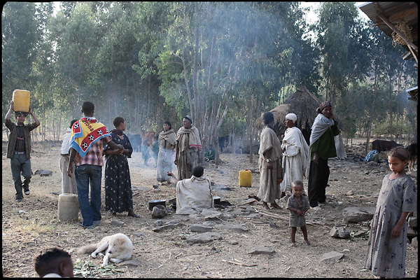 """A small commuity of amhara village prepares food and drinks to serve during the celebration of tthe early marriage of two young girls.. North West of Ethiopia, on saturday, Febrary 14 2009.....In a tangled mingling of tradition and culture, in the normal place of living, in a laid-back attitude. The background of Ethiopia's """"child brides"""", a country which has the distinction of having highest percentage in the practice of early marriages despite having a law that establishes 18 years as minimum age to get married. Celebrations that last days, their minds clouded by girls cups of tella and the unknown for the future. White bridal veil frame their faces expressive of small defenseless creatures, who at the age ranging from three to twelve years shall be given to young brides men adults already...To protect the identities of the recorded subjects names and specific places are fictional."""