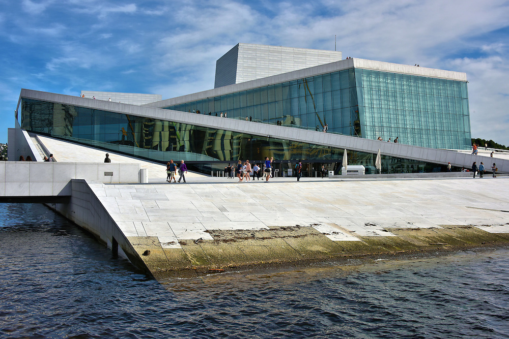 National Opera House in Oslo, Norway<br /> The Oslo Opera House was built in 2007 with reflective glass, La Facciata marble and white granite to give it the appearance of an iceberg floating in the Oslofjord inlet.  The Norwegian National Opera and Ballet conduct over 300 performances a year in the 1,300 seat capacity auditorium and additional stages. It is a beautiful centerpiece to the growing arts and cultural district that is being developed along the Bjørvika waterfront.