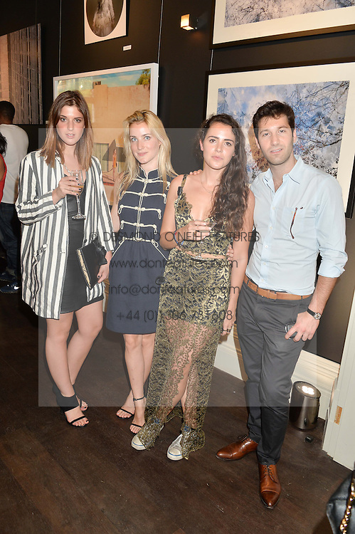 Left to right, ZOE SPRINGER, EKATERINA MALYSHEVA, CAT LAURENCE and ALI KHALIL at a private view and launch of the new Heist Gallery at 43 Linden Gardens, London W2 on 12th June 2014.