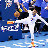 06 May 2016: Oklahoma City Thunder guard Russell Westbrook (0) reacts following a dunk during the San Antonio Spurs 100-96 victory over the Oklahoma City Thunder, during Game Three of the Western Conference Semifinals of the NBA Playoffs at the Chesapeake Energy Arena, Oklahoma City, Oklahoma, USA.
