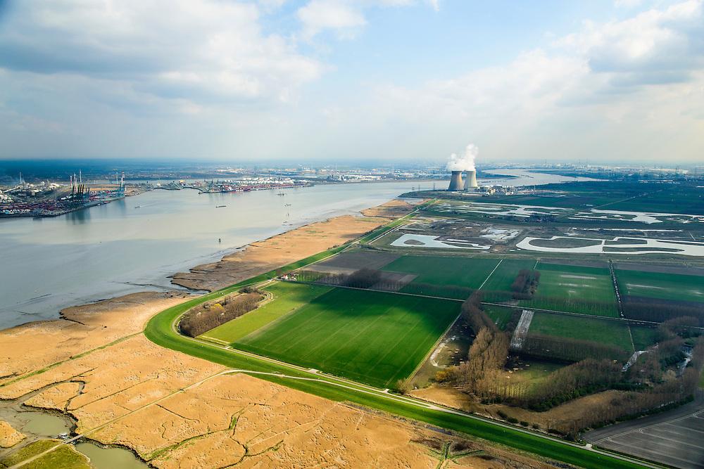 Nederland, Zeeland, Zeeuws-Vlaanderen, 01-04-2016; Hertoging Hedwige polder gezien naar de Belgische Prosperpolder, reeds ontpolderd. Westerschelde links, kerncentrale Doel aan de horizon. In verband met de verdieping van de vaargeul van de Westerschelde moet er volgens de Europese habitatrichtlijn natuurcompensatie komen. Door de polders te ontpolderen wordt er grond terug gegeven aan de natuur, zogenaamde natuurcompensatie. <br /> Hertogin Hedwige polder has to be de-poldered, because of the enlargement of the fairway of the nearby Scheldt, the nature has to be compensated (according to the European Habitats Directive), the measures are controversial. The Belgian Prosperpolder on the horizon and right next to the port of Antwerp is already 'de-polderd' .<br /> luchtfoto (toeslag op standard tarieven);<br /> aerial photo (additional fee required);<br /> copyright foto/photo Siebe Swart