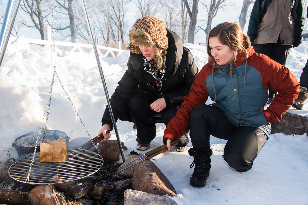 Outdoor cooking class at the Michigan Department of Natural Resources Becoming an Outdoors Woman program at Bay Cliff Health Camp in Big Bay, Michigan.