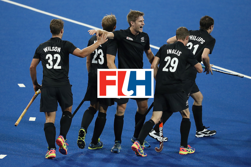 RIO DE JANEIRO, BRAZIL - AUGUST 12:  Nick Wilson #32, Hugo Inglis #29, Shay Neal #23 and Kane Russell #21 of New Zealand react to a goal against Belgium during a Men's Preliminary Pool B match on Day 7 of the Rio 2016 Olympic Games at the Olympic Hockey Centre on August 12, 2016 in Rio de Janeiro, Brazil.  (Photo by Sean M. Haffey/Getty Images)