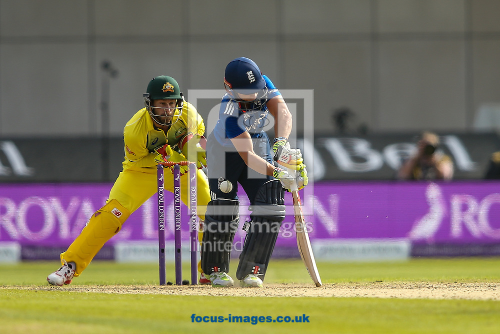 Matthew Wade of Australia (left)  looks on as James Taylor of England plays and misses during the 3rd One Day International match at Old Trafford Cricket Ground, Stretford<br /> Picture by Andy Kearns/Focus Images Ltd 0781 864 4264<br /> 08/09/2015