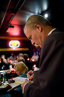 8 October, 2008. New York, NY. Harry Hurt III, columnist of Executive Pursuits for The New York Times,  takes notes in the stage room of the Comic Strip club in Manhattan, NY. He learns how to become a stand-comic and was  trained minutes before by the comic and m.c. D.F. Sweedler. He will then go on stage in front of a live audience.  <br /> <br /> &copy;2008 Gianni Cipriano for The New York Times<br /> cell. +1 646 465 2168 (USA)<br /> cell. +1 328 567 7923 (Italy)<br /> gianni@giannicipriano.com<br /> www.giannicipriano.com
