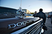 During summer from June to Septemper, every first Friday of the month is Vintage Car Cruising Night. Hundreds of classic American cars cruise around downtown Helsinki and meet at special places to have a good time, here at Kauppatori (Market Square). The Dodge Ram glowing in the midnight sun.