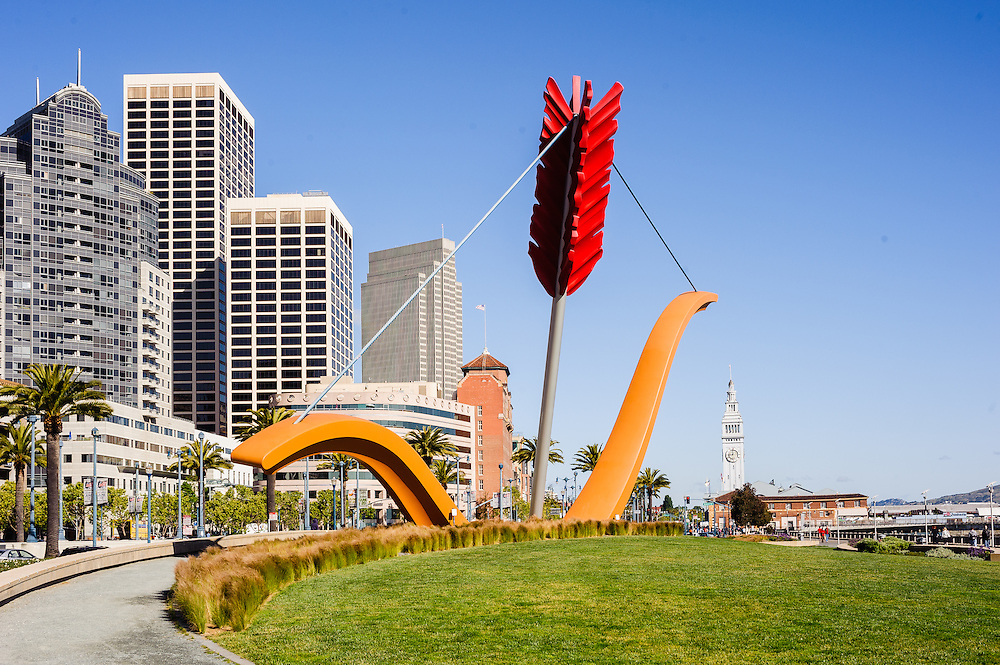 Rincon Park and Cupid's Span, outdoor sculpture by Claes Oldenburg and Coosje van Bruggen, with the San Francisco skyline and The Embarcadero in the background, California