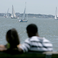 Spectators watch the Cape Fear Yacht Club/State Port Pilot Commodore's Regatta Friday July 4, 2014 in Southport, N.C. (Jason A. Frizzelle)