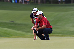 May 2, 2019 - Charlotte, NC, U.S. - CHARLOTTE, NC - MAY 02: Patrick Reed looks over a putt line with his caddy on the 14th green during the first round of the Wells Fargo Championship at Quail Hollow on May 2, 2019 in Charlotte, NC. (Photo by William Howard/Icon Sportswire) (Credit Image: © William Howard/Icon SMI via ZUMA Press)