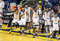 Nov 28, 2018; Morgantown, WV, USA; West Virginia Mountaineers players react on the bench during the first half against the Rider Broncs at WVU Coliseum. Mandatory Credit: Ben Queen-USA TODAY Sports