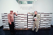 """VENICE, ITALY..June 1997..47th Biennale of Venice.Austrian Pavillion..Oswald Wiener (l.) and Peter Weibel in front of the catalogues of """"Wiener Gruppe""""..(Photo by Heimo Aga)"""