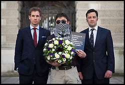 Patrick Hennessy, 30, former soldier (left), former translator Mohammad and Jake Wood, 40 former soldier (right) standing in front of the Foreign Office calling the UK government to grant Afghan interpreters' asylum, with a boquet in memory of the 26 Afghan interpreters who have already been killed while serving with British forces,  London, UK,  03 May 2013. Photo by: Daniel Leal-Olivas / i-Images