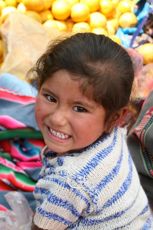 Americas, South America, Peru, Pisac. Young girl in the market.