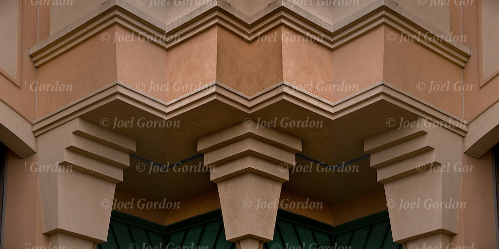 Image flipped and mirrored four times creating a panorama pattern illusion of three cornice brackets, computer generated, on side of building,