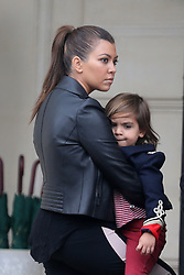 Kourtney Kardashian with her son Mason and friends are spotted spending a good time, leaving their Hotel, shopping on Champs Elysees Avenue and doing tourism bicycle in Paris, France on November 13, 2012. Photo by ABACAPRESS.COM  | 342014_002