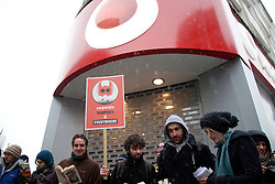 (c) London News Pictures. 18.12.2010. Demonstrators target Oxford Street stores as part of the Pay Day' protest against unpaid taxes by multi-nationals. Picture credit should read: Brian Duckett/London News Pictures