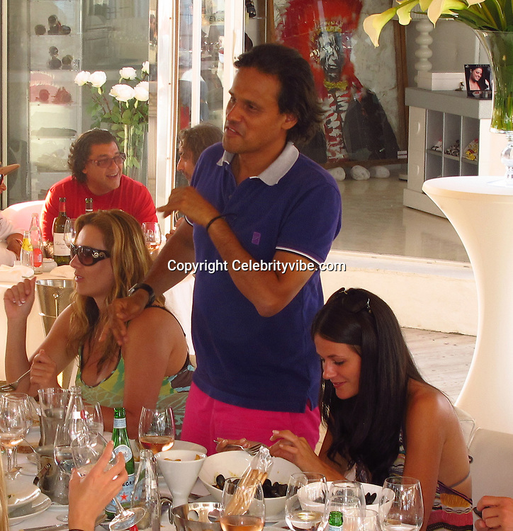 Arun Nayar and girlfriend Kim Johnson. .Liz Hurley ex-husband, Arun Nayar, partying with girlfriend 25-year-old model Kim Johnson. .Le Palmiers Beach Restaurant..St Tropez, France..Friday, July 29, 2011..Photo By CelebrityVibe.com..To license this image please call (323) 325-4035 ; or.Email: CelebrityVibe@gmail.com ;.website: www.CelebrityVibe.com.**EXCLUSIVE**