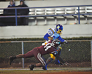 Oxford High's Kenzie Phillips (25) is knocked out of bounds by Picayune's Daveon Greene in the MHSAA Class 5A championship game at Mississippi Veterans Memorial Stadium in Jackson, Miss. on Saturday, December 7, 2013. Picayune rallied to win 42-35.