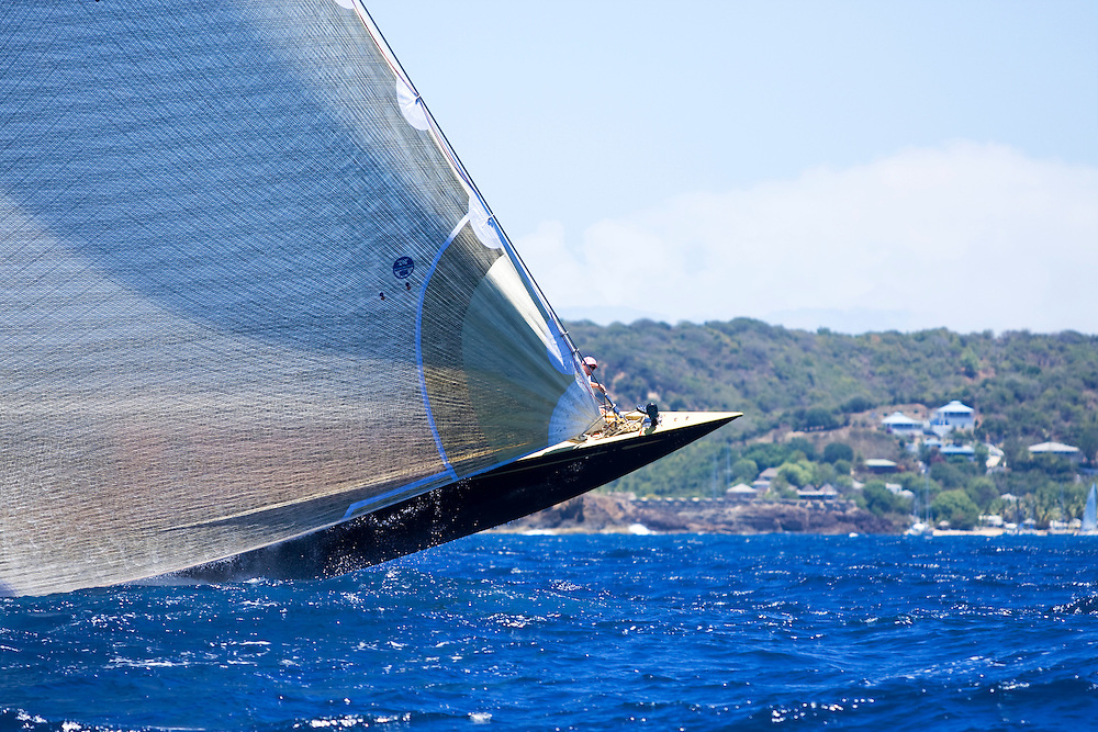 A bow man looks out as the bow of Valsheda slips by Fort Berekely during the 2008 Antigua Classic Yacht Regatta . This race is one of the worlds most prestigious traditional yacht races. It takes place annually off the cost of Antigua in the British West Indies. Antigua is a yachting haven, historically a british navy base in the times of Nelson.