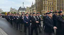 © Licensed to London News Pictures. 18/10/2012. Westminster, UK Members march past Big Ben, Parliament. Members past and present from the 2nd Battalion of The Royal Regiment of Fusiliers march on Parliament today 18 October 2012 to hear a debate in the House on the future of their regiment. The regiment's existence is threatened by the governments plans to reduce the armed forces by 20,000 personel. Photo credit : Stephen Simpson/LNP