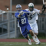 Yorktown, NY / 2008 - Darien''s Tim Clinton, left, shoots and scores during a game between Yorktown and Darien at Yorktown High School April 24, 2008. Yorktown defender Thomas Casey trails behind.  Darien won the game 12-5. ( Mike Roy / The Journal News )