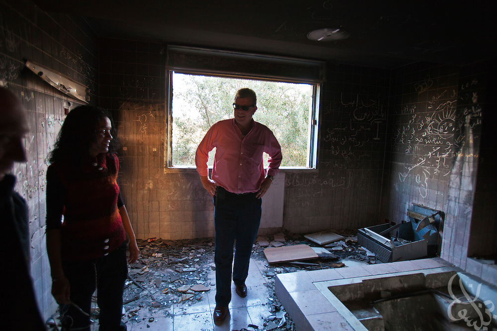 Dr. Ronald Meinardus (l), Regional Director of the Friedrich Naumann Foundation for Liberty (FNF) tours the looted former villa of  deposed  leader Muammar Gaddafi on the grounds of a destroyed military base in  Benghazi, Libya December 16, 2011. Before it was overrun in the first days of the revolution, the base once stood as the city's central garrison for troops and authorities loyal to former leader Muammar Gaddafi. (Photo by Scott Nelson, for Der Spiegel)