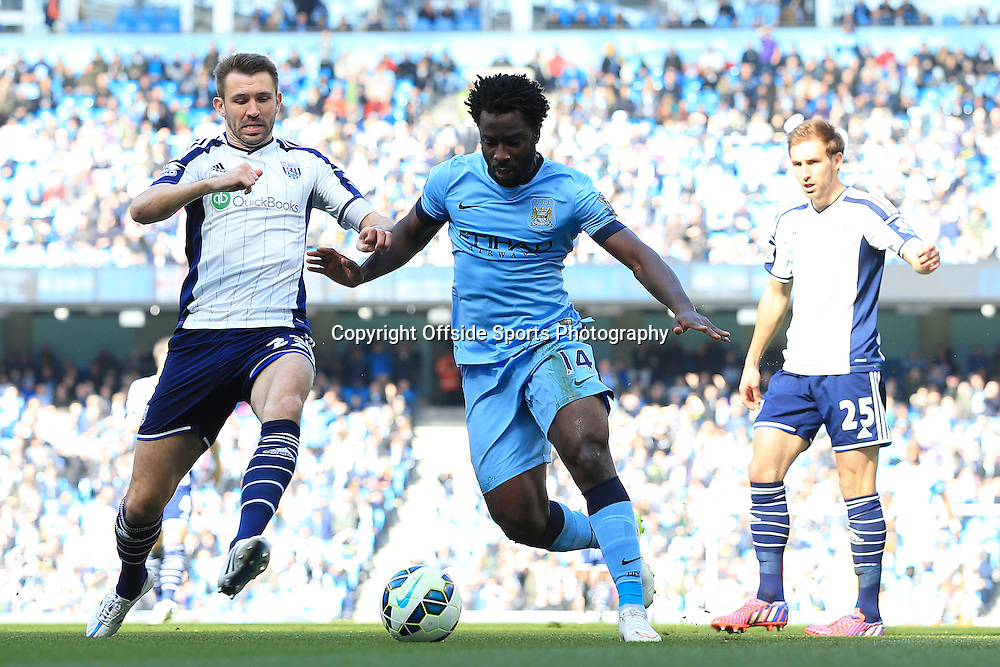 21st March 2015 - Barclays Premier League - Manchester City v West Bromwich Albion - Gareth McAuley of West Brom fouls Wilfried Bony of Man City to earn himself a sending-off, as Craig Dawson of West Brom (R) looks on - Photo: Simon Stacpoole / Offside.