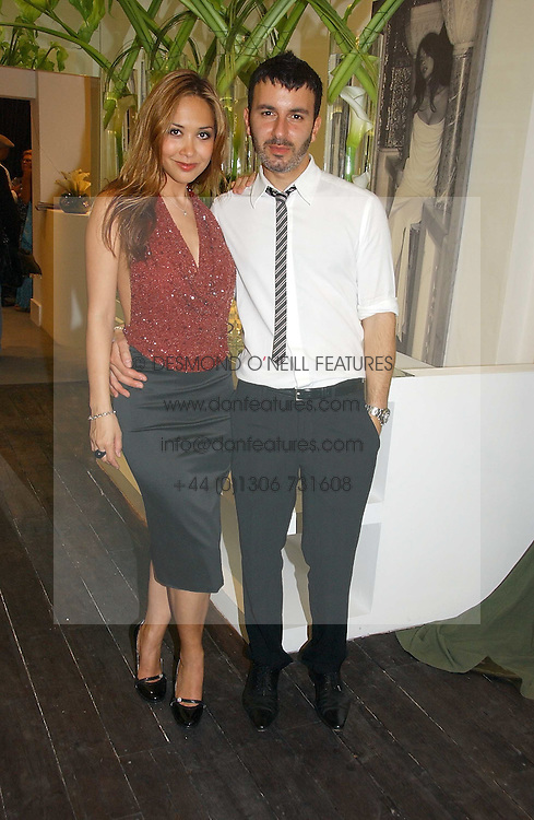 Singer MYLEENE KLASS and fashion designer KYRI (Kyriacos Kyriacus) at the opening of the new Kyri fashion store at 42 Elizabeth Street, London SW1 on 6th September 2006.<br />