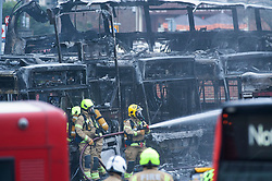 © Licensed to London News Pictures. 22/11/2018. Orpington, UK.Firefighters still working hard this morning to extinguish the blaze. Eleven buses go up in flames as more than 60 firefighters are called to Orpington bus depot fire overnight.Photo credit: Grant Falvey/LNP