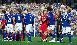 LIVERPOOL, ENGLAND - Saturday, October 1, 2011: Everton's Marouane Fellaini argues with Liverpool's Lucas Leiva after team-mate Jack Rodwell is shown the red card during the Premiership match at Goodison Park. (Pic by David Rawcliffe/Propaganda)