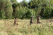 Scene of men hunting with spears in prehistoric times. Image taken from the filming of 'Paris la ville a remonter le temps' written by Carlo de Boutiny and Alain Zenou, directed by Xavier Lefebvre, a Gedeon Programmes production. Picture by Manuel Cohen