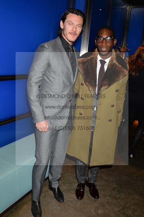Left to right, LUKE EVANS and TINIE TEMPAH at a dinner hosted by Anya Hindmarch and Dylan Jones to celebrate the end London Collections: Men 2014 held at Hakkasan, 8 Hanway Place, London on 8th January 2014.