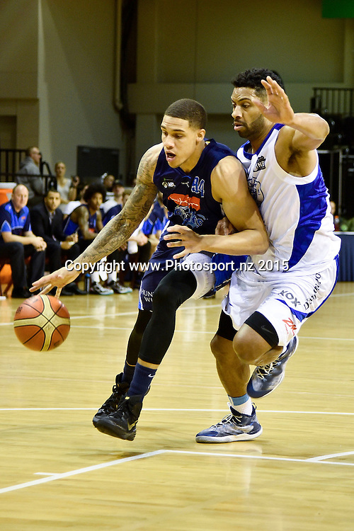 McKenzie Moore (L) of the Giants dribbles the ball with Dion Prewster of the Saints during the NBL semi final basketball match between Wellington Saints and Nelson at the TSB Arena in Wellington on Saturday the 4th of July 2015. Copyright photo by Marty Melville / www.Photosport.nz