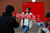 Football - 2019 / 2020 Premier League - Liverpool vs. Wolverhampton Wanderers<br /> <br /> A travelling Reds fan has her photo taken before today's game, at Anfield.<br /> <br /> COLORSPORT/ALAN MARTIN