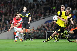 Arsenal's Santi Cazorla shoots outside the box but the shot takes a deflection from Borrusia Dortmund's Sven Bender - Photo mandatory by-line: Alex James/JMP - Tel: Mobile: 07966 386802 22/10/2013 - SPORT - FOOTBALL - Emirates Stadium - London - Arsenal v Borussia Dortmund - CHAMPIONS LEAGUE - GROUP F
