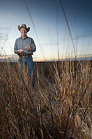 Nick Goode, of Welch, Texas stands in a conservation reserve program (CRP) field.