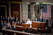 Pope Francis continues his six-day U.S. tour speaking to a joint meeting of Congress at the U.S. Capitol in Washington, District of Columbia, U.S., on Thursday, Sept. 24, 2015. The Pope is calling for Americans to do more to fight poverty, curb climate change and help immigrants. His visit runs through Sept. 27, and features stops in Washington, New York and Philadelphia. Photographer: Pete Marovich/Bloomberg