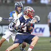 Ryan Boyle #14 of the Boston Cannons controls the ball during the game at Harvard Stadium on May 17, 2014 in Boston, Massachuttes. (Photo by Elan Kawesch)