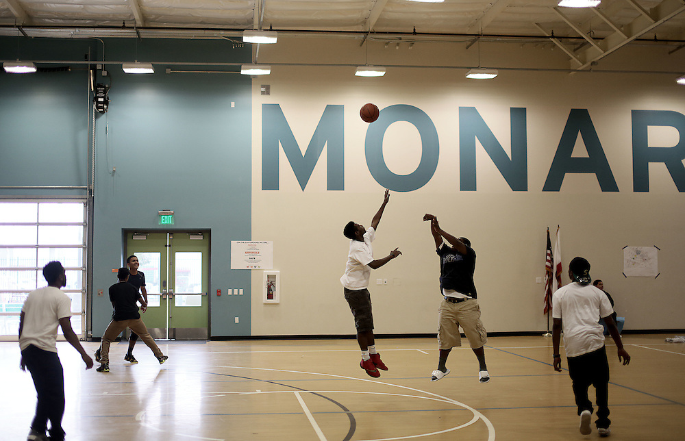 Students play basketball during lunch period at the Monarch School in San Diego, CA on Friday, May 15, 2015.  The Monarch School is the largest elementary through High School facility that caters to students that are homeless or are have associations with homelessness.(Photo by Sandy Huffaker for The Atlantic)