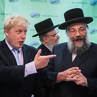 London, UK - 7 August 2014: The Mayor Boris Johnson and Rabbi Oscher Schapiro of the Orthodox Jewish community in Stamford Hill, London